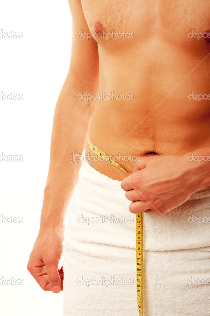 Young man measuring his waist — Stock Photo #5741526
