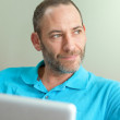 Man at home with laptop - casual — Stock Photo #5665712