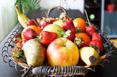 Fruits basket in living room — Stock Photo