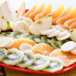 Plate with fresh fruits — Stock Photo