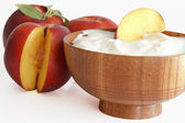 Yogurt with peaches — Stock Photo