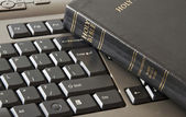 Holy Bible and keyboard — Stock Photo