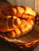 Fresh croissants in basket — Stock Photo