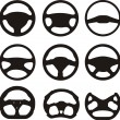 Stock Vector: Silhouettes of steering wheels