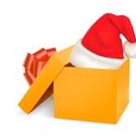 Christmas gift box and santa hat. Vector. — Stock Vector