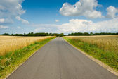 A road and blue sky — Stock Photo