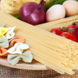 Italian pasta with vegetables and eggs - Stock Photo