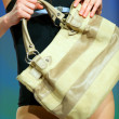Fashion model shows a modern bag — Stok fotoğraf