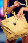 Fashion model shows a modern bag — Stock Photo