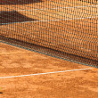 Empty tennis court and ball - Stock Photo