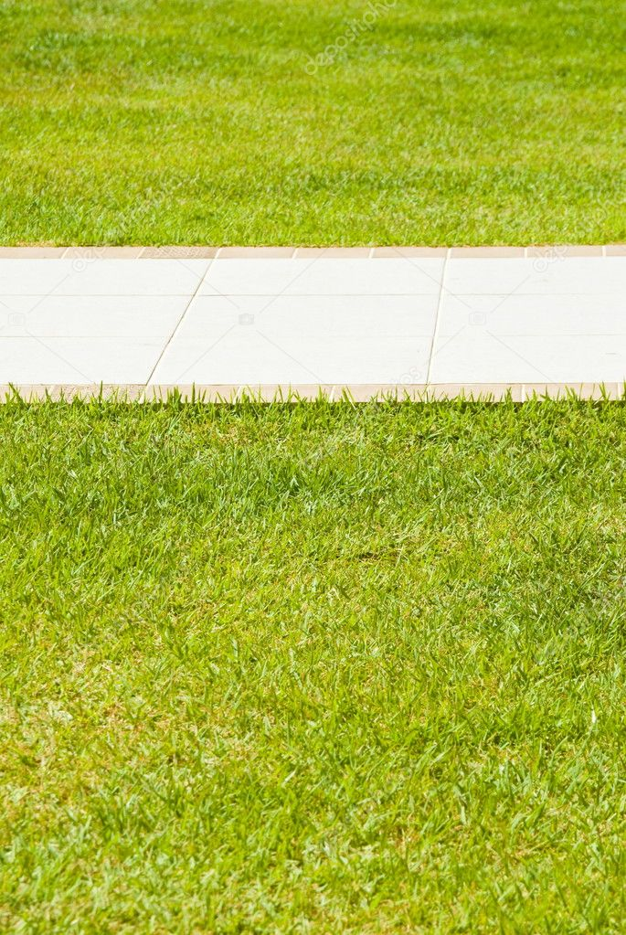 Sidewalk in the green grass, photo of — Stock Photo #5824138