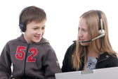 Children in headphones with laptop computers — Stockfoto