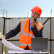 Engineer in orange jacket and helmet — Stock Photo