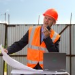 Stock Photo: Engineer in orange jacket and helmet