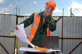 Engineer in orange helmet and jacket. — Stock Photo