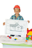 Boy in orange helmet with house drawing — Stock Photo
