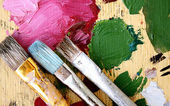 Palette and brushes — Stock Photo