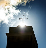 Cross sign shining by the sun — Stock Photo