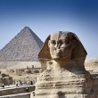The Great Sphinx and the Pyramids - Stock Photo