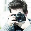 Stock Photo: A young photographer man