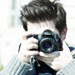 A young photographer man - Stock Photo