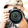 Man holding a camera - Stock Photo