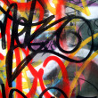 Metal wall with colorful graffiti tags - Stock Photo