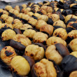 Delicious grilled chestnuts as background - Stock Photo