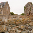 Country Breton house on Pink Granite Coast in Brittany - Stock Photo