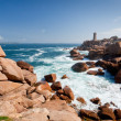 Rose lighthouse on Pink Granite Coast in France — Stock Photo #5718950
