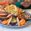 Plate with cut crab and seafood — Stock Photo