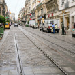 Street with tram road in town — Stock Photo