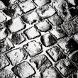 Wet cobbled roadway - ストック写真