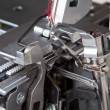 Thread in needle of sewing machine closeup — Stock Photo