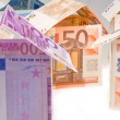 Expensive houses from euro banknotes — Stock Photo
