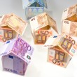 Expensive houses from euro banknotes - Stok fotoğraf