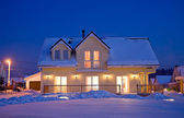 Country house in winter evening — Stock Photo