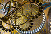 Bronze candlesticks and ceiling of Hagia Sophia, Istanbul — Stock Photo
