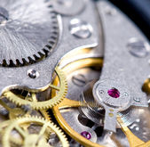 Spring and gears — Stock Photo