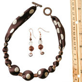 Brown polka dot silk beads and earrings — Stock Photo