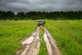 Car on country road in rain day — Stock Photo