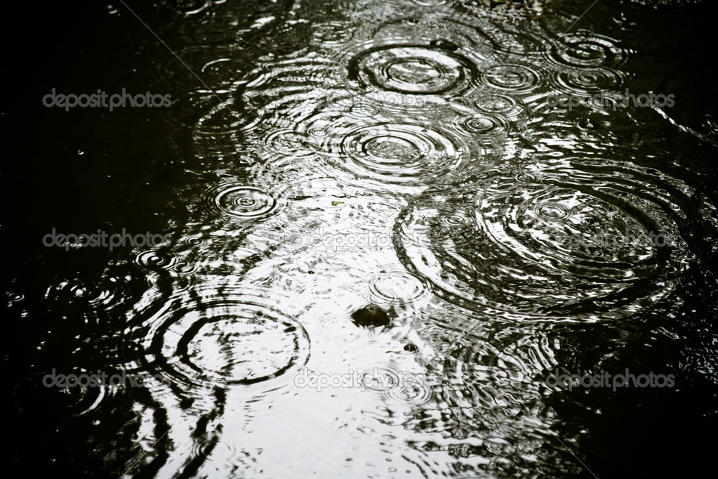 Circle on water from rain spots  Stock Photo #5719891