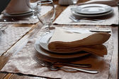 Flatware on wooden table in tavern — Stock Photo