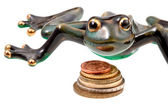 Ceramic frog and coins — Stock Photo