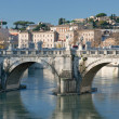 Old town (Rome) through bridge on Tiber — Stock Photo