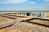 Railroad and old small pier — Stock Photo
