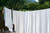 Drying of white linens — Stock Photo