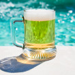 Glass of cold beer in hot summer day — Stock Photo