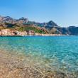 View on Taormina and Gardini Naxos beach, Sicily - Stock Photo