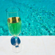 Glass of white wine on pool board outdoor — Stock Photo